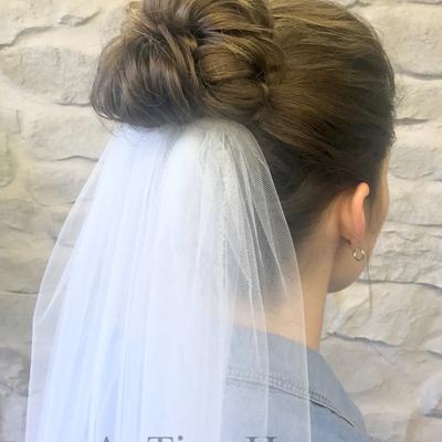 Brautfrisur-mit-dutt-und-schleier